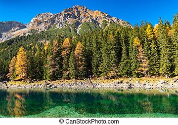 Autumn colours at mountain lake in the Alps, Austria, Tyrol, Lake Obernberg, Stubai Alps.