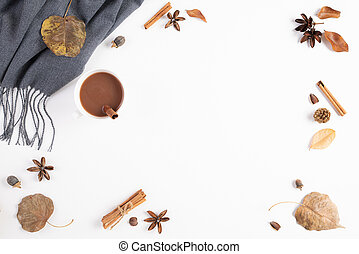 Autumn composition. Cup of coffee, blanket, autumn leaves on white background. Flat lay, top view copy space.