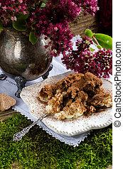 Autumn composition with a dessert of tiramisu