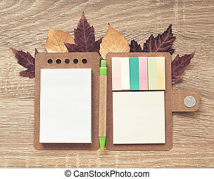 Autumn composition with notebook
