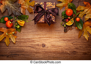 Autumn concept with leaves and gift box