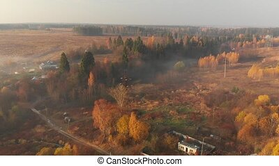 autumn countryside on a foggy morning in Russia - Flying...
