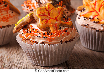 Autumn cupcakes decorated with cream and leaf. horizontal