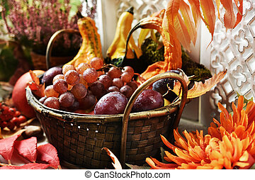 autumn decoration with basket of fruits and gourds