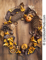 Autumn decorative frame with mushrooms, acorns, pumpkins, dried leaves ,pine cones