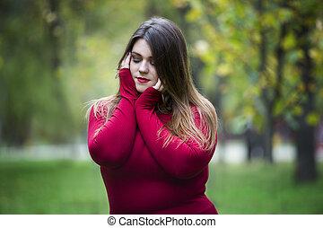 Autumn depression, young beautiful caucasian plus size model...
