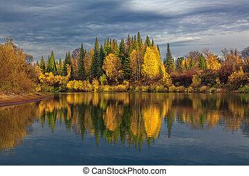 Autumn evening in wild Siberian taiga