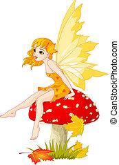 Autumn fairy elf sitting on mushroom