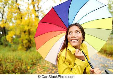 Autumn / fall - woman happy with umbrella in rain