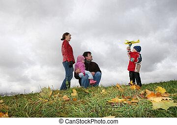 autumn family with plane