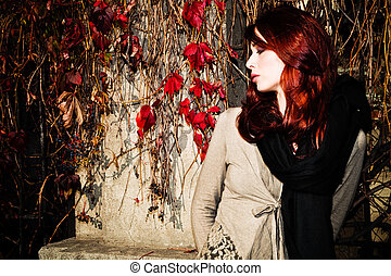 autumn fashion - red hair young woman in sunny autumn...