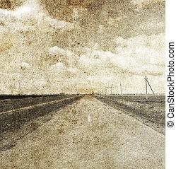 Autumn field near way. Photo in old image style.