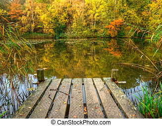 Autumn Fishing Lake scene - Lovely image of fishing jetty on...