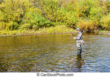 Autumn fishing on a small river