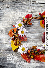 autumn  floral wreath on rustic wooden background