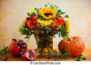 Autumn flowers and pumpkin