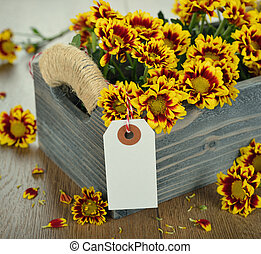 Autumn flowers in a wooden box
