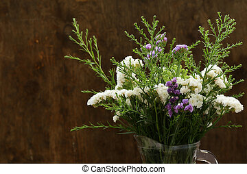 autumn flowers still life on a wooden background