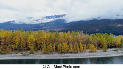 Autumn forest and mountain ranges along the lake 4k - Autumn...
