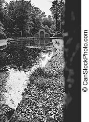 Autumn forest cabin for boats in a park in Black & White. -...