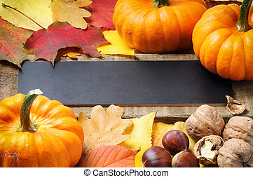 Autumn frame with pumpkins, walnuts and leaves