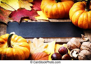 Autumn frame with pumpkins