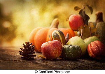 Autumn fruit - Autumn nature concept. Fall fruit on wood