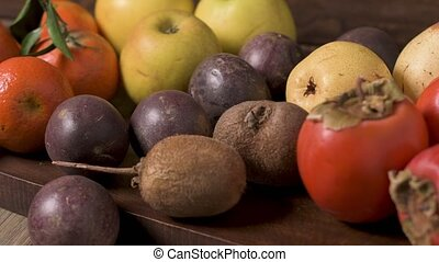 Autumn fruits on rustic table in vintage style.