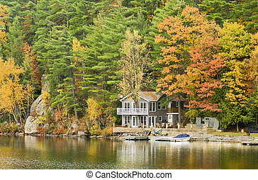 A beautiful cottage on the lake surrounded by the splendor of Autumn.