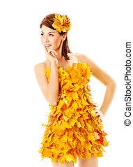 Autumn girl in dress of maple leaves over white