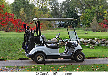 Autumn golfcart - Caddy golfcart by the field in the autumn