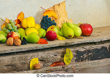 lots of fruits on the wooden desk