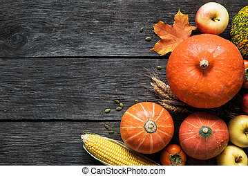 Autumn harvest border with pumpkins, apples, corn and fallen leaves