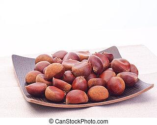 Autumn harvest of chestnuts