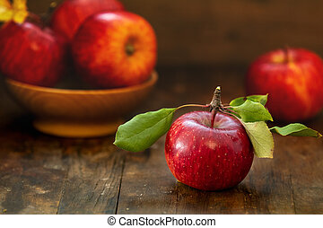 Autumn harvest red apples fruits on a wooden table background
