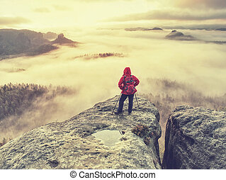 Autumn hike in foggy rocky mountains for hard adventurer