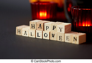 wooden toy blocks with happy halloween letters