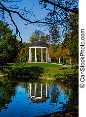 Autumn in the park Orangerie, Strasbourg, reflection in the water