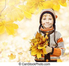 autumn kid in leaves, little child in woolen hat