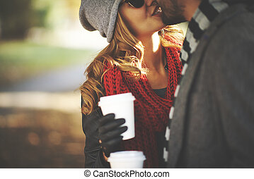 Autumn kiss - Young people kissing outdoors