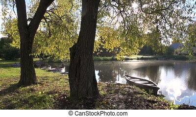 autumn lake landscape with boat