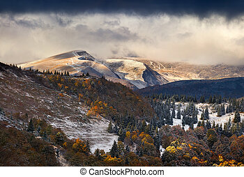 Autumn landscape in the mountains. First snow