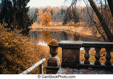 Autumn landscape on a forest and a lake with an old balcony.