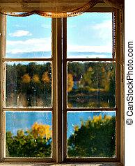 Autumn landscape seen through window
