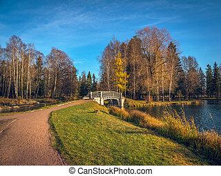 Autumn landscape. Stone bridge in autumn Park.