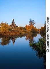 autumn landscape with a wooden church