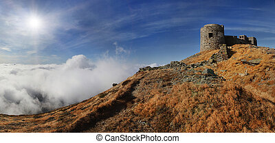 Autumn landscape with ancient fortress in the mountains