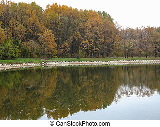 Autumn landscape with colorful forest, lake and reflectio