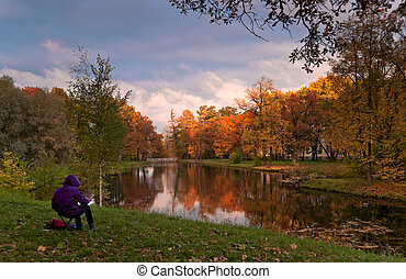 Autumn landscape with painter
