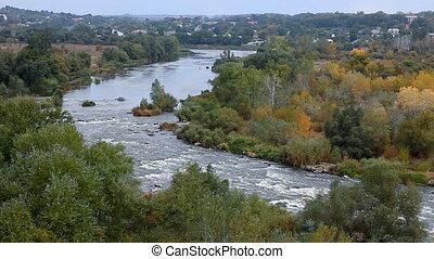 Autumn landscape with rafting on river, Ukraine, Yuzhniy Bug River